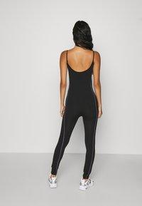 Karl Kani - SMALL SIGNATURE CATSUIT - Jumpsuit - black - 2