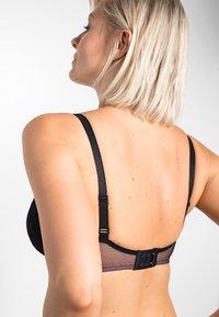 Triumph - AMOURETTE CHARM - Underwired bra - black - 6