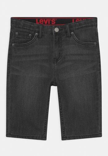 PERFORMANCE  - Denim shorts - black denim