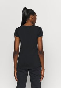 Under Armour - T-shirts basic - black - 2