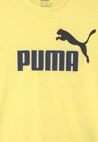 Puma - LOGO UNISEX - Print T-shirt - yellow pear - 2