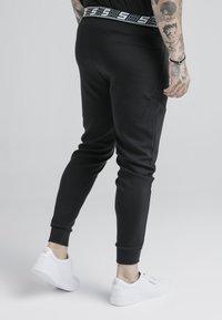 SIKSILK - EXHIBIT FUNCTION PANTS - Pantalones deportivos - black - 4