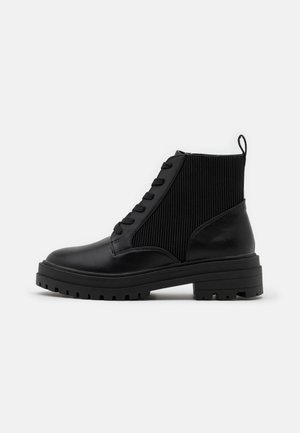 BOOST ELASTIC LACE UP - Lace-up ankle boots - black