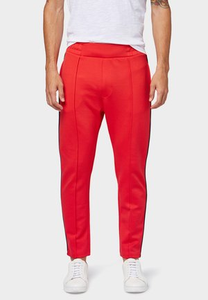 MIT TAPE-DETAILS - Tracksuit bottoms - red