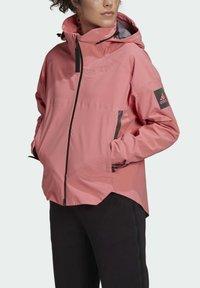 adidas Performance - Waterproof jacket - pink - 3
