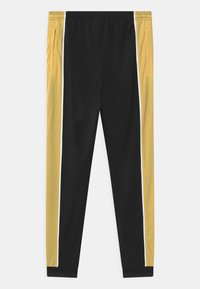 Nike Performance - ACADEMY UNISEX - Pantalon de survêtement - black/saturn gold/white - 1