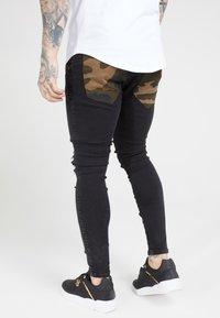 SIKSILK - BURST KNEE LOW RISE - Jeans Skinny Fit - washed black - 2
