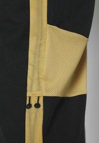 Nike Performance - DRY ACADEMY PANT - Verryttelyhousut - black/jersey gold/white - 5