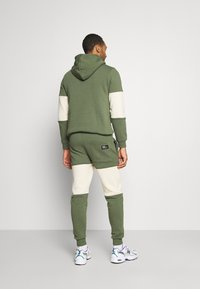 Redefined Rebel - DAWSON  - Tracksuit bottoms - thyme - 2