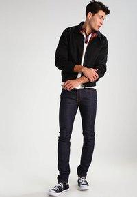 Nudie Jeans - THIN FINN - Jeans slim fit - organic dry ecru embo - 1