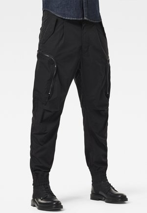 FLIGHT RELAXED TAPERED CUFFED - Cargo trousers - dk black
