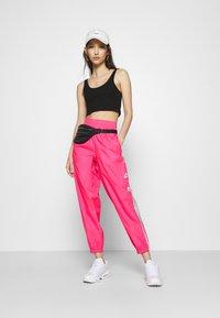 Nike Sportswear - PANT  - Pantalon de survêtement - hyper pink/white - 1