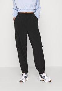 Vero Moda - VMCOCO PANT - Cargo trousers - black - 0