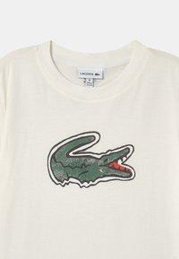 Lacoste - LOGO UNISEX - Print T-shirt - white - 2
