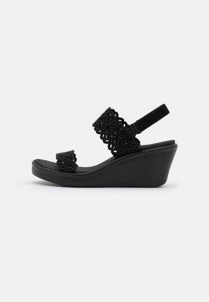 RUMBLE ON - Platform sandals - black