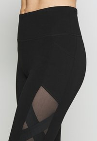 DKNY - HIGH WAIST LEGGING CRISSCROSS SIDE BANDS - Leggings - black - 4