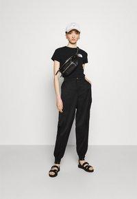 The North Face - COORDINATES TEE - Print T-shirt - black - 1