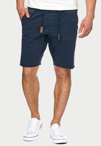 CARVER - Denim shorts - blue