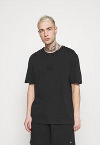 adidas Originals - BADGE UNISEX - T-Shirt basic - black - 0