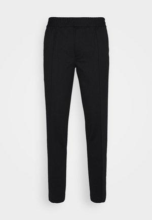 Pantalones - black