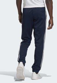 adidas Originals - ADICOLOR CLASSICS PRIMEBLUE SST TRACKSUIT BOTTOM - Tracksuit bottoms - blue - 1
