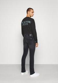 Calvin Klein Jeans - SKINNY - Skinny džíny - black - 2