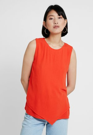 ÄRMELLOS - Blouse - orange