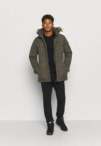 Jack Wolfskin - GLACIER CANYON - Winter coat - brownstone - 1