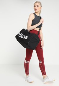 adidas Performance - LIN CORE  - Sports bag - black/white - 1