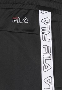 Fila - JAIRUS TAPE TRACK PANTS - Tracksuit bottoms - black - 3