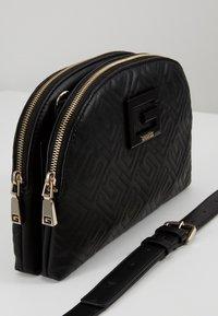 Guess - JANAY STATUS  - Across body bag - black - 4