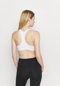 Nike Performance - FUTURA BRA - Medium support sports bra - white/black - 2