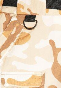Karl Kani - SIGNATURE CAMO CRINCLE PANTS - Cargo trousers - beige/sand - 6