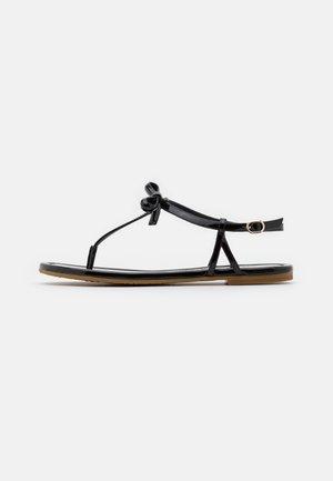 PIAZZA - T-bar sandals - black