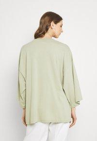 Monki - BILLA TEE - Basic T-shirt - green dusty light - 2