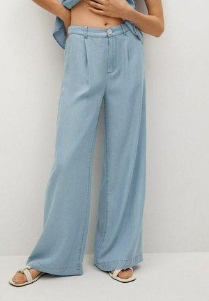 Jeans a zampa - azul medio