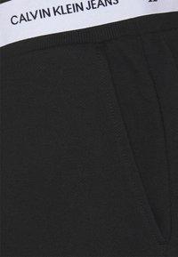 Calvin Klein Jeans - TAPE TRACK PANT - Pantaloni sportivi - black - 6