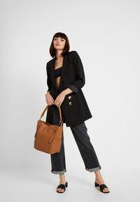FREDsBRUDER - NEW TRUE - Handbag - dark camel - 1