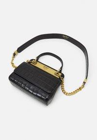 DKNY - COOPER FLAP XBODY CROCO - Handbag - black/gold-coloured - 3
