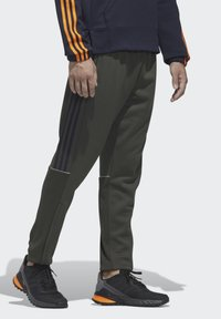 adidas Performance - INTUITIVE WARMTH SERENO JOGGERS - Tracksuit bottoms - green - 4