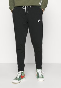 Nike Sportswear - Tracksuit bottoms - black/ice silver/white - 0