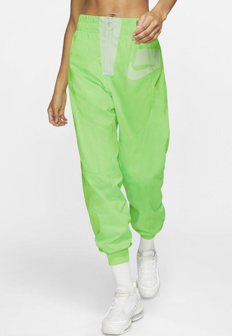 Nike Sportswear - Tracksuit bottoms - green strike/vapour green/white