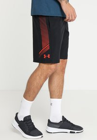 Under Armour - GRAPHIC SHORTS - Korte sportsbukser - black/radio red - 0