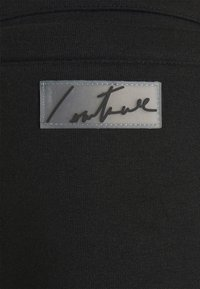 The Couture Club - ESSENTIALS - Tracksuit bottoms - black - 5