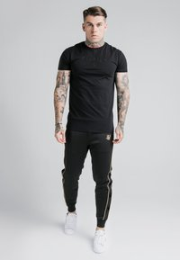 SIKSILK - ASTRO CUFFED TRACK PANTS - Tracksuit bottoms - black/gold - 1
