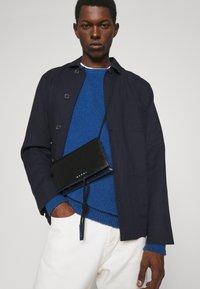 Marni - MUSEO SOFT MINI UNISEX - Across body bag - black/navy blue - 1