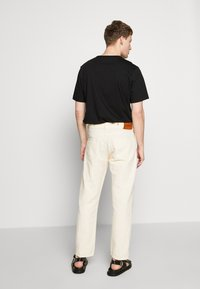 YMC You Must Create - TEARAWAY - Džíny Relaxed Fit - ecru