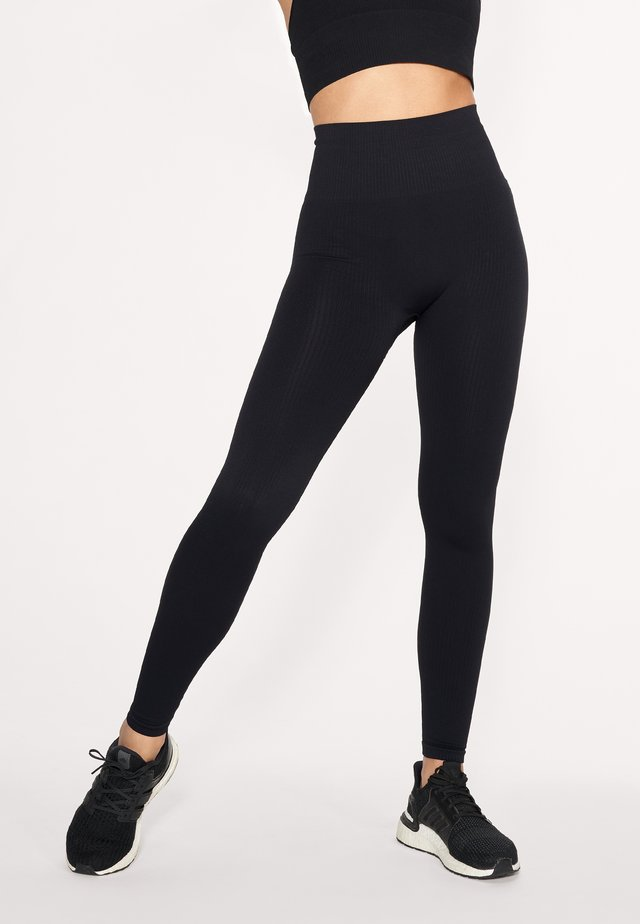 SEAMLESS RIB - Tights - black