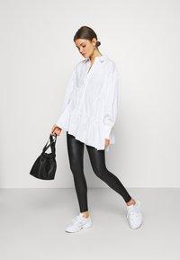 Topshop - WET LOOK - Leggings - Trousers - black - 1