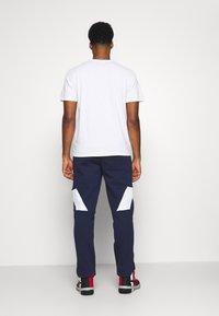 Puma - PARQUET - Pantalon de survêtement - peacoat - 2